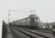 NS Stoptrein wacht op passerende sneltrein bij Maarsbergen.Achterop de foto staat: 9536 J G C v/d Meenen Mbg 29.12 ...