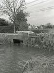 AB_KOUWENHOVENSEWEG_002 Een heul in de Kouwenhovenseweg. Op de achtergrond woningen langs de Oudelandsedijk; Mei 1997