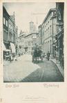 1877 Gezicht op de Lange Delft te Middelburg met een rijtuig met koetsier ter hoogte van de Herenstraat, op de ...