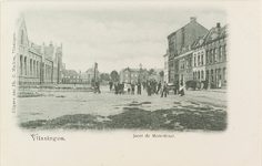 4196 Gezicht op de Joost de Moorstraat te Vlissingen met aan de linkerzijde een schoolgebouw en poserende personen