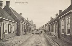 5107 Gezicht op de Dorpsstraat, thans Van Tilburghstraat te Driewegen met links het café Het Wapen van Driewegen, met ...