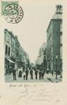 5157 Gezicht op de Lange Kerkstraat te Goes vanaf de Markt; rechts het stadhuis