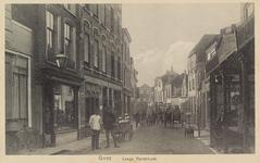 5282 Gezicht op de Lange Vorststraat in Goes in de richting van de Ganzepoortstraat, met rechts Magazijn De Handzaag