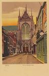 5363 Gezicht op de Maria Magdalenakerk in Goes vanuit de Korte Kerkstraat, met links een pakhuis van wijnen en likeuren ...