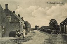 8445 Gezicht op de Dorpstraat te Retranchement met een vrouw met kinderwagen