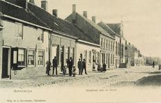 8463 Gezicht op de Ooststraat te Schoondijke met het gemeentehuis