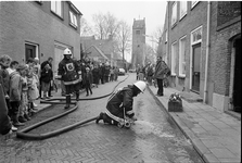 JVH-1577 Oosterland. Kerkstraat. 'Brand' in pastorie Hervormde Kerk. Regionale brandweerwedstrijden, die werden ...