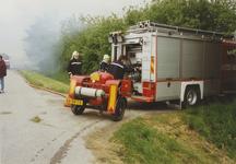 950011 Brandweerauto bij een brand in een boerenschuur in de Dijckmeesterpolder bij Philippine