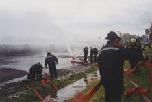 960109 Brandweeroefening van de regio-bijstand aan de Nijverheidsstraat te Sas van Gent