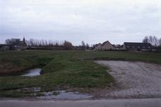 DIA70038 De kerk gezien vanaf de Sluisweg. Woningen langs de Willem Alexanderstraat; ca. 1991