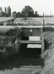 GV_OOSTENRIJK_14 De heul onder de Konijnendijk, op de achtergrond de voormalige watermolen langs het Oostenrijk; ca. 1980