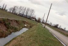 OH_TUSSENWEG_03 Inspectie van ingezakte slootkant langs de Tussenweg; 1994