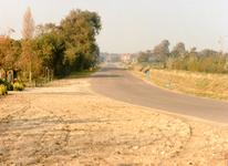 RO_LANGEWEG_02 De Langeweg ter hoogte van de kruising met de Middelweg (rechts) in de richting van het Kreekpad; 1995