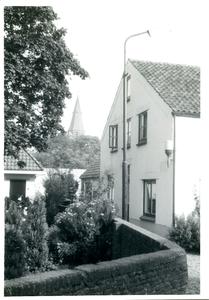 Woonhuis voorheen schilder Bart de Gier met doorgang tussen de Brink en Ds. Pollaan