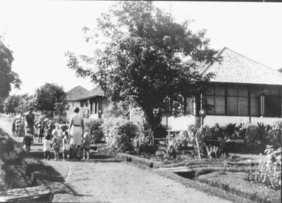 A street in Kampili Camp, 1945.<br/>NIOD 57473 <a class=uline href=http://www.beeldbankwo2.nl target=_blank>Beeldbank WO2</a>